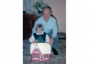 Alison with her first doll house built by her grandfather for Christmas.